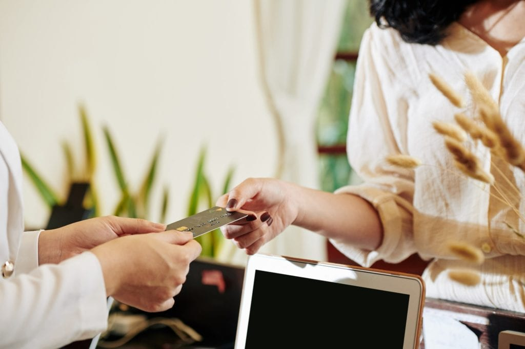 Hotel guest paying for service